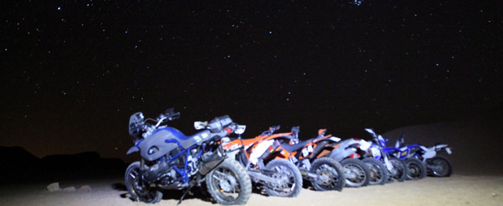Bikes row night sky moto
